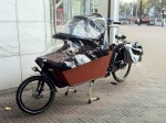 Most of the cargo bikes had rain covers to protect the little ones.