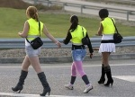 In Spain, prostitutes walk the streets in high viz boleros.
