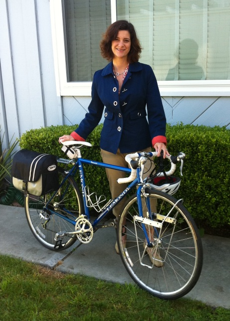 Updated Classics: Navy blazer with toggle buttons and a touch of orange on me, and touring racks on Lily, my first road bike.
