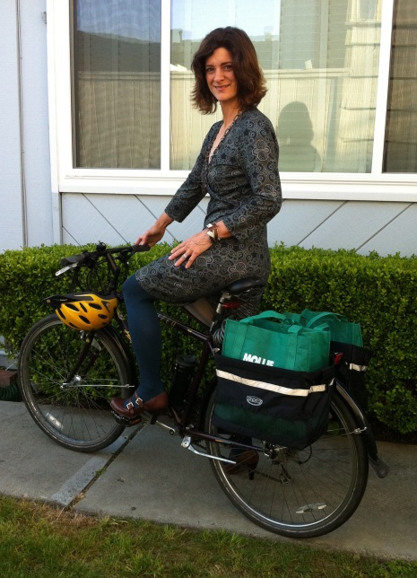 To Market I Go: An easy knit dress, teal tights, and Mary Jane heels on me, and grocery bag panniers on Zella.