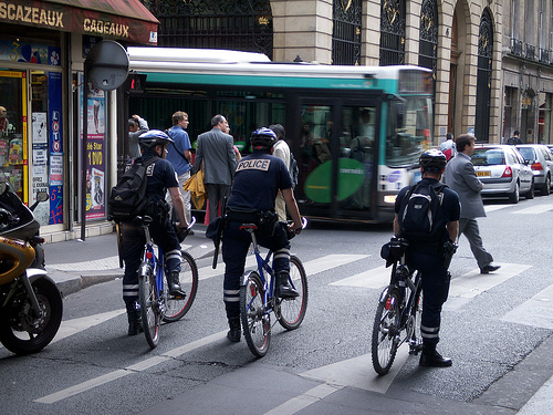 In Paris, gendarmes ride bikes without high viz uniforms.