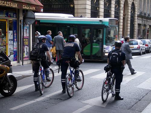 In Paris, gendarmes ride bikes without high viz uniforms.