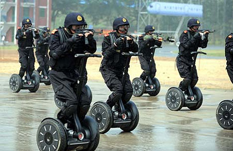 Chinese police on Segways don't need high viz. They have machine guns.