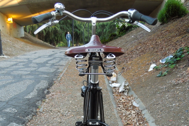 The Brooks B67 saddle has springs for upright riding on potholed streets.