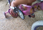 Her sandals are superhero silver and super girly.