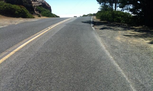 Toward the peak, the road steepens cruelly.