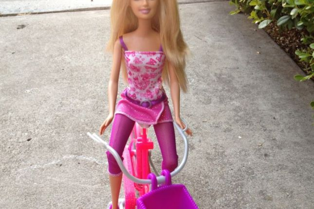 Barbie's tank top, wrap skirt and leggings are as practical as they are glam.