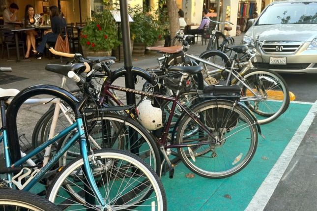 On Cowper Street, there was so much demand the city replaced a car parking spot with a bike corral.
