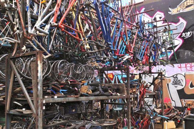 Behind the shop are shelves of vintage bike frames awaiting reincarnation.