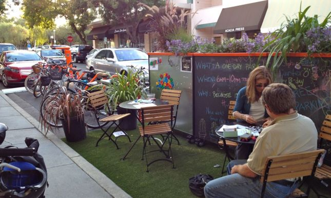 The adjacent parking spaces had outdoor table seating and a chalk wall to decorate.
