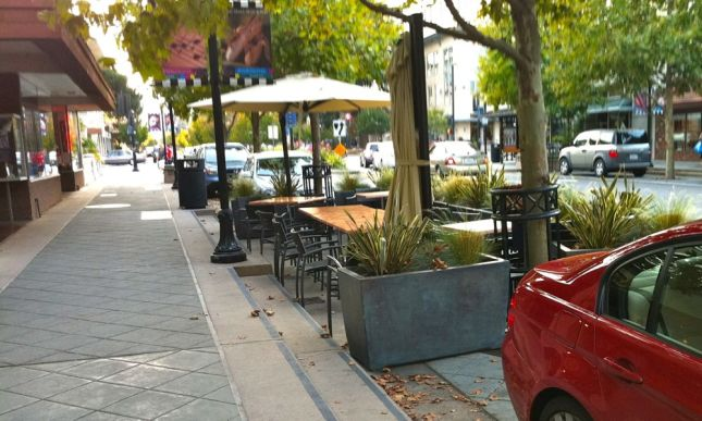 Businesses get to choose if they want parking or outdoor seating.