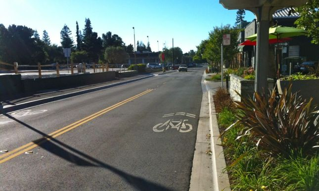 These misplaced sharrows are on a popular bicycle route, between stop signs on short city blocks.