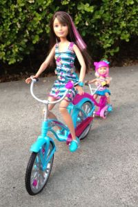 Skipper has a cruiser too, with a trail-a-bike for little sister Chelsea.