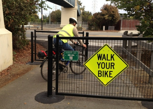 "The sign says ""walk your bike"" but it's wide enough that no one does."
