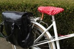 A polka dot seat cover keeps my leather saddle dry and clean too.