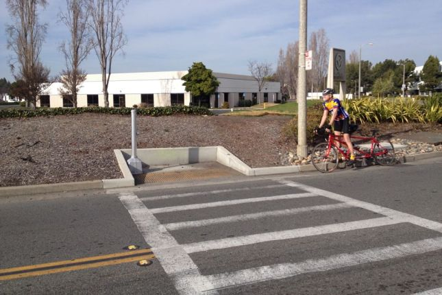 For the pedestrians coming off the bridge, it's a crosswalk to nowhere. No sidewalks and steep curbs to boot.