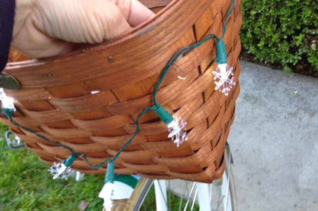 Unfolded paper clips were quick, easy and cheap for attaching lights to my woven basket.