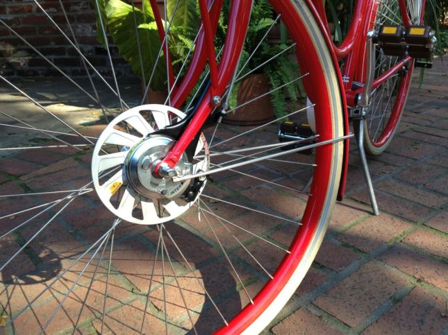 Looks like a disk brake, but it dissipates heat from the hub roller brakes.