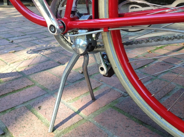 The original kickstand couldn't handle a heavy load like this center stand.