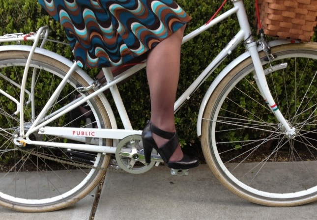 The wave-print knit dress flows easily and comfortably on the bike.