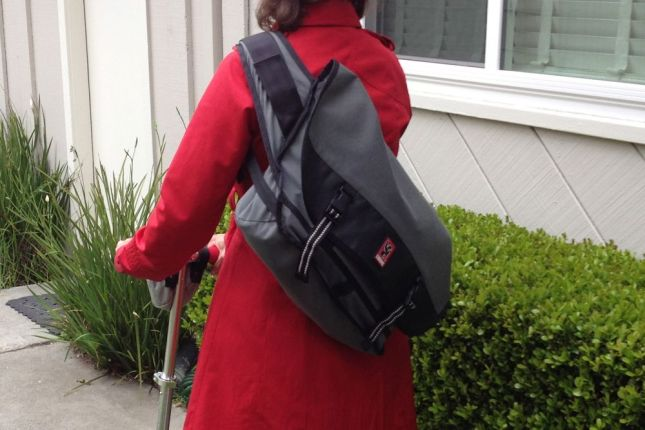 The messenger bag from Chrome wraps securely around my back.