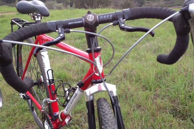 The in-line brake levers are handy when you're riding the top of the bars on unpredictable dirt.