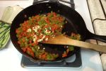 Chop onion, green and red peppers, mince garlic, and saute until soft in olive oil. Skip this step if you're really lazy.