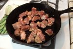 "Chop pork into 1"" cubes, season generously with Cajun spice, and brown it in a dutch oven or skillet."