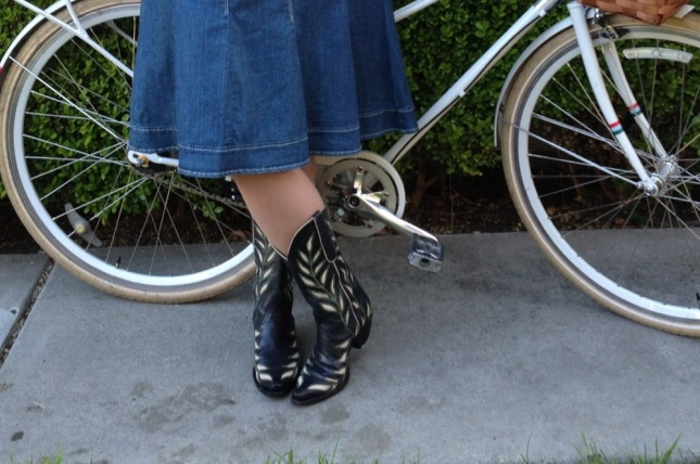 The denim skirt is full for pedaling but heavy enough to stay down in the wind.