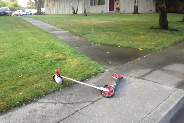 The scene of the incident: wet pavement + slight downhill + oblique angle = scooter FAIL.