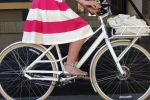The 1950s full-skirted silhouette is fresh, flattering and flirty, especially on a pretty step-though bike.