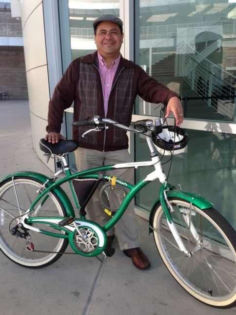 Plaid zip cardigan and a flat cap with a classic green and white cruiser.