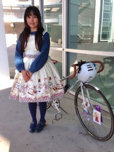 Sweet as cupcake in a pinafore and mary janes on a drop-bar mixte.