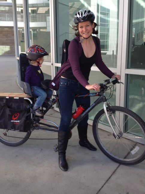 Scoop neck T, light sweater, slim jeans and boots on an long-tail Xtracycle.