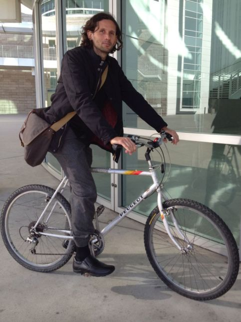 Euro style jacket and messenger bag on a vintage French mountain bike.