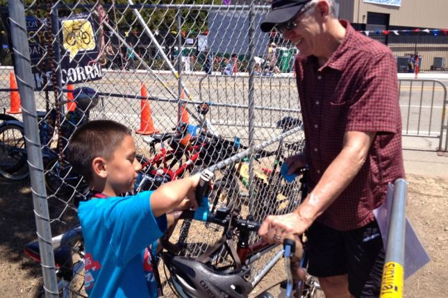 This young volunteer did a very professional job as a bike valet. The corral was ginormous.