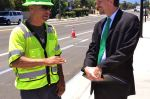 Dressed in a suit and power green tie, Hans adds color the launch of San Jose's first green lane project.