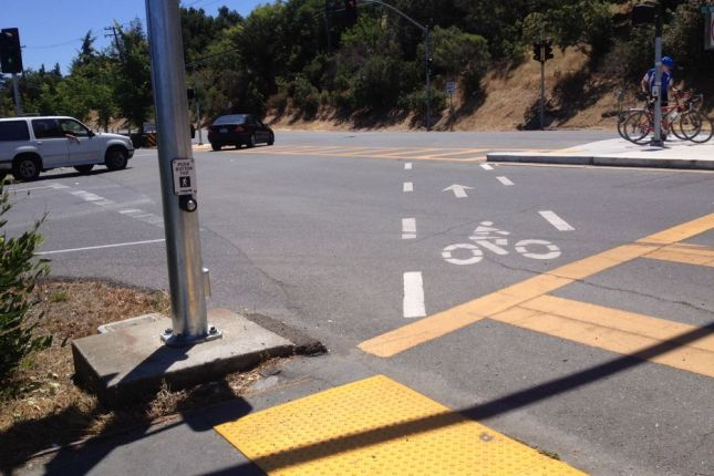 Their alternative path through Foothill College leads riders through the intersection awkwardly at best.