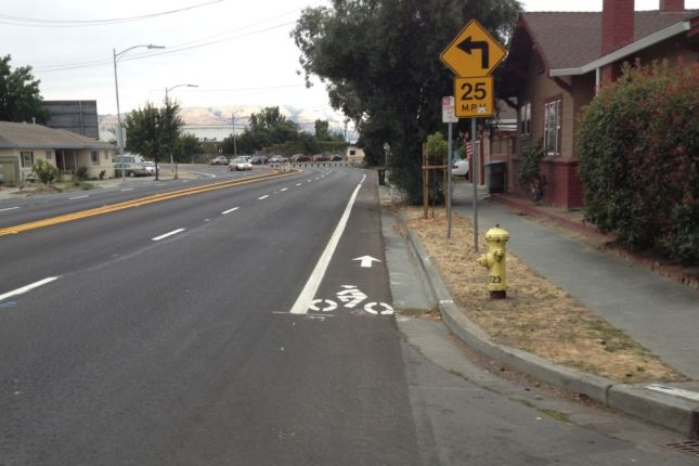 Near Hwy 101 the bike lane becomes a narrow strip and traffic speeds up.
