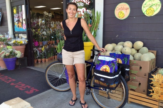 Two bags of heavy fruit later, Katie rode home with a smile.