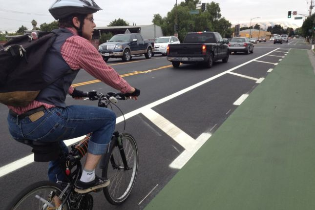 Even though Mitch is willing to ride in traffic on busy streets, he loves the new green lanes too.