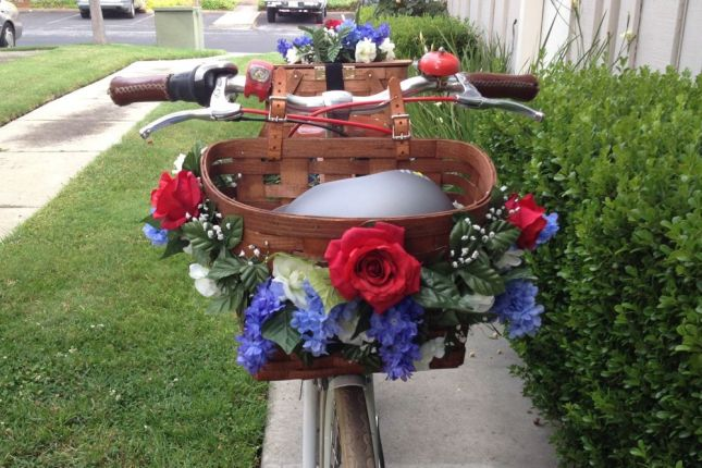 Cottage charm meets patriotic spirit with red, white and blue flowers on an American-made  wicker basket.