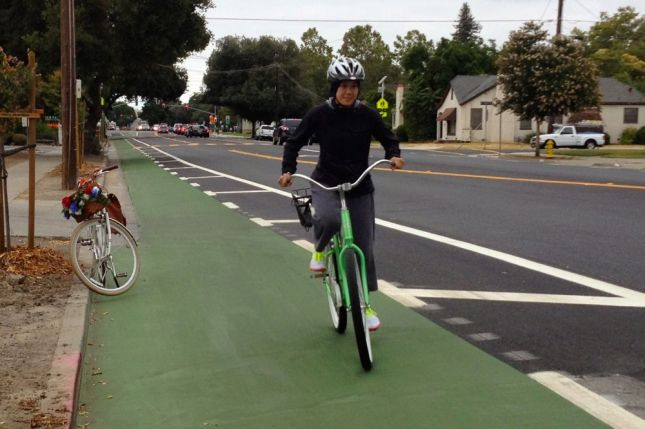 "She finds the wide green bike lanes comfortable, even though ""some cars don't get it yet."""