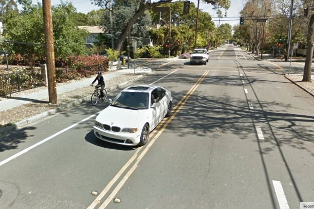 The bike lane continues north across Oak Grove past Nativity School.