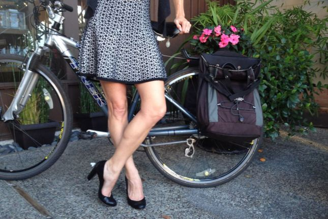 Feeling flirty in a short flare skirt with strong cycling legs.
