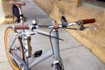 Faux leather grips and the bell were standard. Brian added the headlight and the commuter coffee mug.