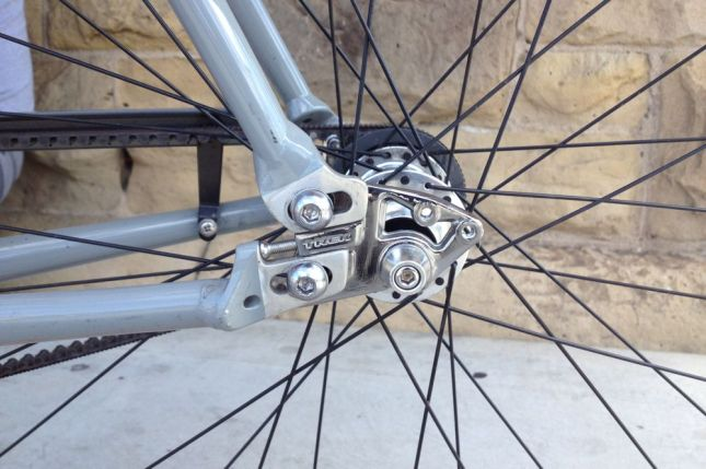 Unlike chains, belts can't be removed by popping a link. Hence the split rear triangle frame.