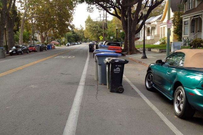 Sigh. The other side of the street wasn't any better. Garbage day means bike lanes that stink in San Jose.