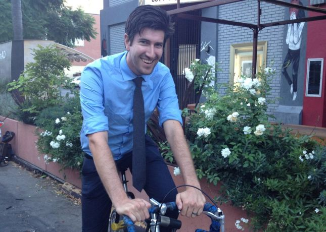 Ryan confessed that he gets a kick out of wearing a tie on the bike.