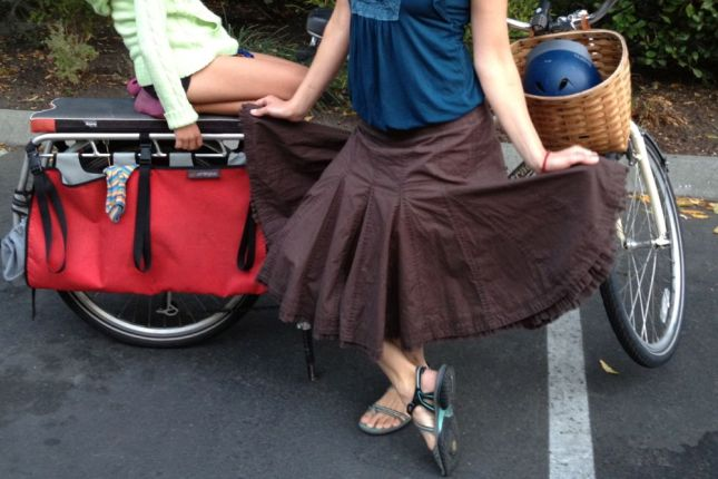 Talk about having full range of motion! The gores in her godet skirt add width, volume, swing and kick.